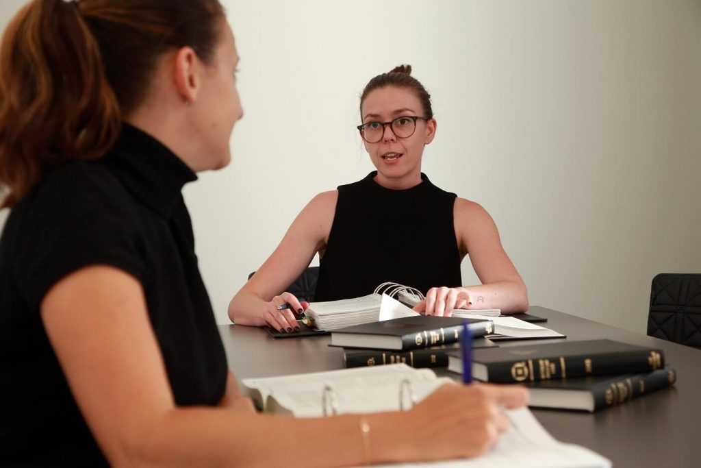 two women in a meeting with legal documents